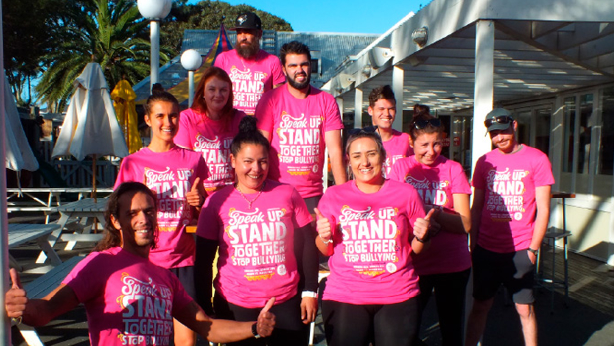 graeme Dingle Foundation Bay of Plenty team smiling with thumbs up wearing pink shirts