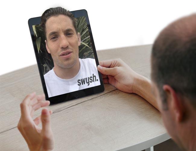 Man holding iPad with Sports star